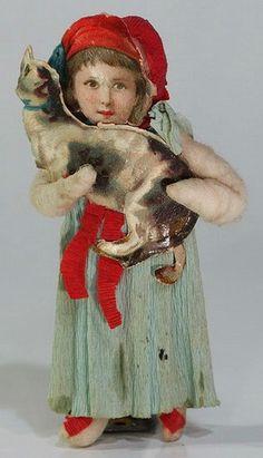 Girl holding cat Christmas ornament. Spun cotton, crepe paper, Victorian scrap.