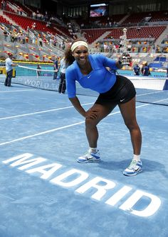 Serena Williams poses after winning the Madrid title.