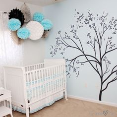 Aqua Nursery for a Baby Girl - we love the whimsical poufs over the crib!
