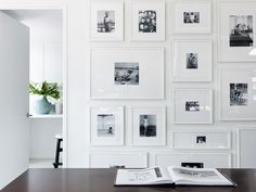 Darryl Carter | love the gallery wall of family photos with overly wide white mats and white frames.