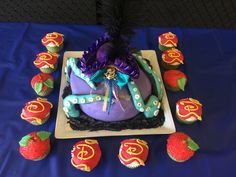 Uma Descendants 2 Cake with logo cupcakes and apple cupcakes for birthday party. Logos and cake made with fondant. Huge hit with the Kids!