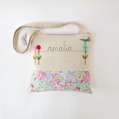 such pretty personalized tote on Etsy, each one made to order.