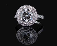 2ct round brilliant cut diamond  bezel set with micropave set halo and band