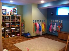 Kids playroom-I love the dress up hooks, instead of the messy costume bin I have now..