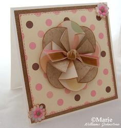 Make these paper folded round, rosette and floral style embellishments for your handmade cards and scrapbooks with the craftymarie.com tutorial on oval tea bag folding.