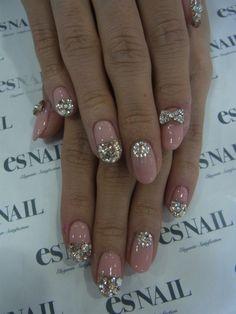Glitter rhinestone bow & samon pink nails