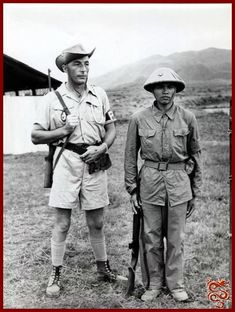 A French soldier and a Communist Viet Minh soldier at Trung-gia, where the French and Viet Minh held a meeting in 1954 to arrange a truce. Reproduced by permission of Corbis-Bettmann. Vietnam Ho Chi Minh, Saigon Vietnam, Vietnam Vets, Vietnam Image, Vietnam War Photos, First Indochina War, French Foreign Legion, French Colonial, French History