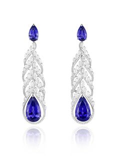 Chopard high jewellery earrings featuring pear shaped tanzanites surrounded by white gold set with diamonds.
