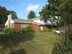 206 Morgan St, Waynesville 65583 - Huge home with 4 levels located in the Waynesville city limits. This home offers 4 large bedrooms on the upper level with the master having 2 closets and a nice bathroom with double vanities. The kitchen is easy to manuver in and has plenty of cabinets. The main level features a large foyer area with room for benches/chairs, and there is a nice family room with built in book cases, a half bath and laundry room. There is also an unfinshed basement.
