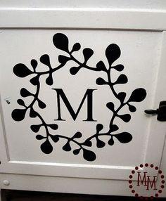 Monogram on cupboard door...