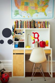 Ikea Micke desk and Kvart lamp paired with an Eames chair in a New York apartment.