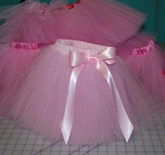 Satin Waistband Tutu Tutorial.  This looks great.  I hate the ones where you tie tulle strips to the elastic.  They're messy and pull the elastic.  Will have to try this one!