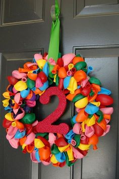 cute idea - Birthday wreath with the age number in the middle. Great way for guests to find the birthday party house!A cute idea - Birthday wreath with the age number in the middle. Great way for guests to find the birthday party house! Homemade Door Wreaths, Diy Wreath, Wreath Ideas, Birthday Balloon Wreath, Birthday Balloons, Birthday Wreaths, 2nd Birthday Parties, Diy Birthday, Homemade Birthday Decorations