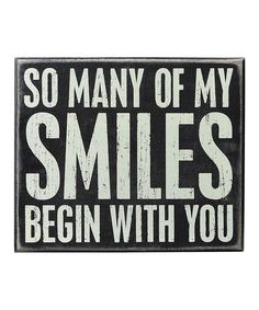 Primitives by Kathy My Smiles Box Sign | This rustic box sign is an eye-catching addition to any décor scheme. Crafted from sturdy wood, it displays a heartfelt message sure to inspire the whole family.