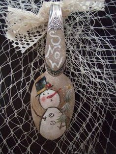 Painted  Snowmen, Snowlady's Spoons!!!  TUTORIAL @Laurie's Charming Designs: A little primitive guy Snowman that LOVEs snow!! I thought I might tell you how I do these: 1)I clean the back of the with silver cleaner, then wash and dry them. 2)I have this Huge Orange hammer...I hit them a few times. Its sitting on a heavy metal thingy. 3)Then I try to find something round to bend it around...