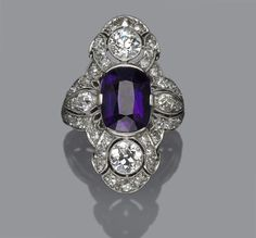Property of various owners  An art deco amethyst and diamond ring, circa 1925  centering an oval-shaped amethyst; signed D.& Co.; estimated total diamond weight: 2.50 carats; mounted in platinum