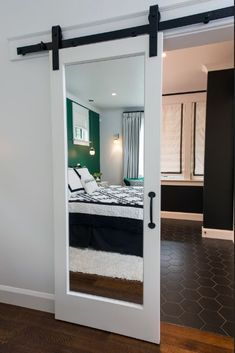 A Sliding Barn Door From Baird Brothers Mirrored On Both Sides Leads To The Master Bathroom Where T Remodel Bedroom Bathroom Remodel Master Living Room Remodel
