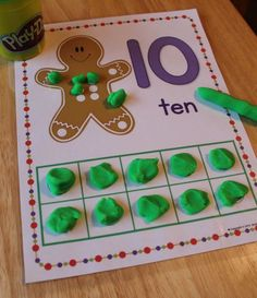 Gingerbread counting and fine motor fun - gingerbread play dough mats are great December activity for preschool, pre-k, and kindergarten age kids.  Kids can learn numbers, numeral recognition, number formation, counting, and composing and decomposing numbers....a great hands-on math and counting activity.  Perfect for your gingerbread or Christmas theme math centers or work stations.