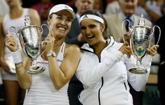 July 11, 2015 -- Martina Hingis of Switzerland, left, and Sania Mirza of India hold their trophies after winning the Women's Doubles Final against Ekaterina Makarova of Russia and Elena Vesnina of Russia at the All England Lawn Tennis Championships in Wimbledon, London.