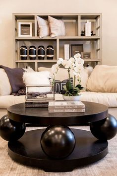 Moody living space with bold statement coffee table mixed with fresh flowers to balance it out. Loving the contrast in here on the Alice Lane Home showroom floor
