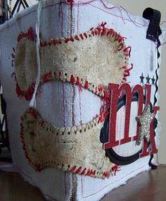 Such an adorable idea for binding a baseball album!