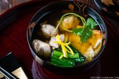 Kanto Style (Eastern Japan) Ozoni recipe is typically made of clear dashi broth, toasted mochi, chicken, and seasonal green vegetable.