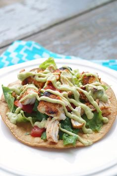 Grilled Chipotle Chicken Tostadas are the perfect summer entertaining meal! Sweet and smoky topped with a cool homemade avocado cream sauce!
