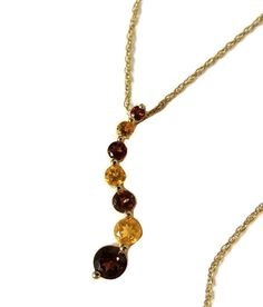 https://www.etsy.com/listing/265720762/mt-washington-antique-vase-blue-satin?ref=shop_home_active_7 This journey style pendant has 4 brilliant cut Garnets and 3 brilliant cut Citrine stones. (.46 ctw Garnet & .15 ctw Citrine). The stones are vivid in color