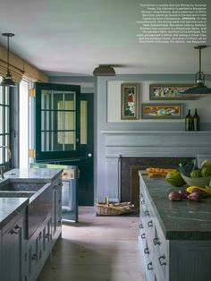 1840's Bridgehampton farmhouse designed by Steven Gambrel with his masculine esthetic. Cabinetry is painted in Benjamin Moore's Hearthstone, Sonoma Forge sink fittings and collection of 1930's Bea Evan paintings.