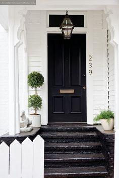 glossy black doors & topiaries are my favorite.