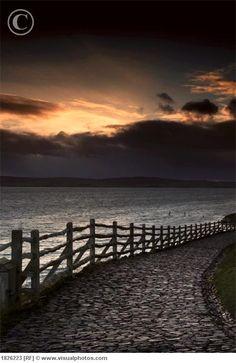 A stone path along the water, Holy Island, Berwick, Northumberland, England