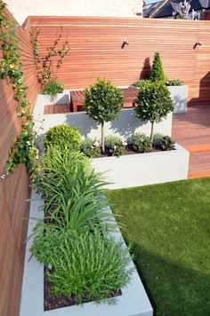 Modern Garden Design Artificial Grass Raised Beds Hardwood Decking Cedar Privacy Screen Bespoke Fireplace BBQ Balham Clapham Battersea Chelsea Fulham London Contact anewgarden for more information Back Garden Design, Modern Garden Design, Backyard Garden Design, Contemporary Garden, Backyard Designs, Raised Bed Garden Design, Back Gardens, Small Gardens, Outdoor Gardens