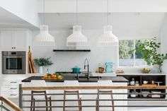 The light and bright kitchen at HGTV Dream Home 2018 with white Shaker cabinets and handsome wood-topped island has a clean and contemporary style with a user-friendly open layout. Hgtv Kitchens, Bright Kitchens, Dream Home Gym, Hgtv Dream Homes, White Shaker Cabinets, Kitchen Pictures, Kitchen Ideas, Garage Pictures, Kitchen Inspiration