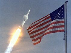 "Apollo 11 launch~The American flag heralded the launch, the first Lunar landing mission, July 16, 1969. The massive Saturn V rocket lifted off from NASA's Kennedy Space Center with astronauts Neil A. Armstrong, Michael Collins, and Edwin ""Buzz"" Aldrin at 9:32 a.m. EDT. Four days later, on July 20, Armstrong and Aldrin landed on the Moon's surface while Collins orbited overhead in the Command Module."