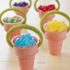 Mini Baskets: Fill ice cream cones with jelly beans. With a small knife, carefully cut two holes into the sides of each cone. Tuck either end of an apple licorice stick into the holes to serve as an edible handle. #Easter