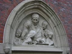 Froebel stone relief at Wheelock College in Boston