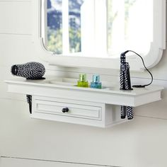 "getting-ready space. The mirror has a carved wood frame in white. The matching shelf has a broad surface for holding a hair dryer, while the drawer holds additional primping accessories.  Shelf: 27"" wide x 9.5"" deep x 6"" high   Shelf features a drawer and four storage cubbies.   Key-hole mounting(hardware included)"