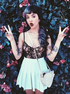 #8 Melanie Martinez: Princess of the Background Outfit: Floral Crop Top and Skater Skirt