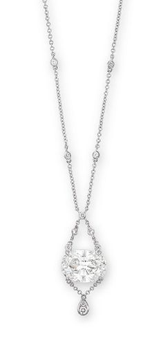 A DIAMOND PENDENT NECKLACE  Set with an oval-shaped diamond weighing 5.04 carats, suspended from an entwined collet-set diamond neckchain, terminating in a brilliant-cut diamond drop, mounted in 18k white gold