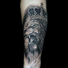 Unique Heavily Shaded Tattoo Of Lion With Crown On Male #TattooIdeasMale