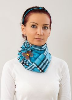 Wear a scarf with a brooch! Not necessarily this pair but good idea.