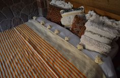 Stylish Moroccan pom pom blanket handloomed in the souk of Marrakech. With a field in ivory and contrasting orange striping trimmed with oversized pom poms on both ends.   Blankets and cushions available on my website www.beyondmarrakech.com