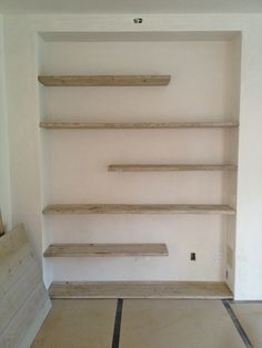 Scaffolding planks used as shelves.. From the Giannetti team Brooke and Steve. Fabulous ideas as always!