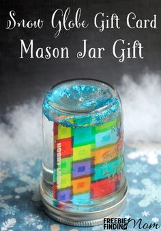 Snow Globe Gift Card Mason Jar Gift - Show the gift receiver that you put effort into their gift by turning an ordinary gift card into an adorable glittery snow globe with this DIY gift in a jar.