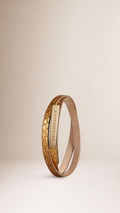 Burberry Metallic Gold Wraparound Metallic Alligator Bracelet - Unique wraparound metallic alligator bracelet. Graphic hand-painted edges, polished metal plaque. Discover more accessories at Burberry.com