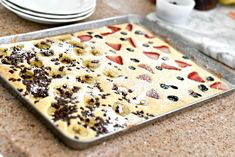 "Make life easier with these ""Sheet Pan Pancakes""! Try it with two different toppings and the result is a sheet pan of beautifully baked pancakes you can cut into squares to serve with your favorite syrup. Quesadillas, Baked Pancakes, Fluffy Pancakes, Waffles, Semi Sweet Chocolate Chips, Quick Snacks, Healthy Snacks, Savoury Cake, Breakfast Recipes"