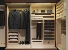 Ceccotti, made in Italy: Gentleman wardrobe, project by Guglielmo Ulrich. Structure in rosewood, internal in maple wood, handles in ebony and rosewood, internal drawer unit, metal parts in polished brass. doors in briar root or in parchment.
