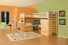 Orange And Green Kids Wall Decor With Wood Bunk Beds For Three Child And Wood Computer Desk With Deep Blue Rocking Chair