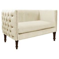 """Offer guests a comfortable seat with this stylish essential, brimming with beach-chic appeal for lasting enjoyment.Product: SetteeConstruction Material: Solid pine frame, polyester and polyurethane foam padding and fabric upholsteryColor: Antiqued whiteFeatures: Handmade in the USADimensions: 33"""" H x 52"""" W x 28"""" DNote: Easy assembly requiredCleaning and Care: Spot clean only"""