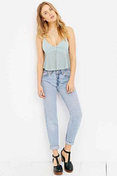 Butterfly tank with high-waisted denim jeans